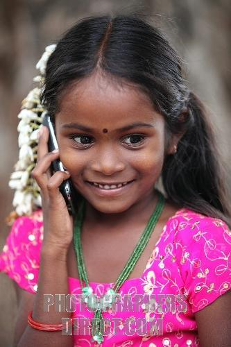Indian kid using Mobile